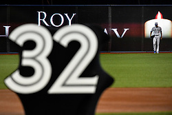 March 29, 2018 - Toronto, ON, U.S. - TORONTO, ON - MARCH 29: A Jay's player walks in front of  a candle on the field display during a ceremony honoring the late pitcher Roy Halladay.  The team retired Halladay's No. 32 on opening day before the MLB season game between the New York Yankees and the Toronto Blue Jays at Rogers Centre in Toronto, ON., Canada March 29, 2018. Jays players will also wear a no. 32 patch on their jerseys throughout the season in tribute to Halladay. Halladay, nicknamed 'Doc' who spent 12 seasons as a pitcher with the Jays, died in November 2017 when his personal plane crashed into the Gulf of Mexico near Tampa. He was 40 years old. Halladay joins Robero Alomar (no. 12) as the only 2 players in Jays history to have their jersey numbers retired. (Photo by Jeff Chevrier/Icon Sportswire) (Credit Image: © Jeff Chevrier/Icon SMI via ZUMA Press)