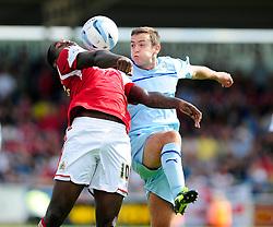 Bristol City's Jay Emmanuel-Thomas controls the ball under pressure from Coventry City's Blair Adams - Photo mandatory by-line: Dougie Allward/JMP - Tel: Mobile: 07966 386802 11/08/2013 - SPORT - FOOTBALL - Sixfields Stadium - Sixfields Stadium -  Coventry V Bristol City - Sky Bet League One