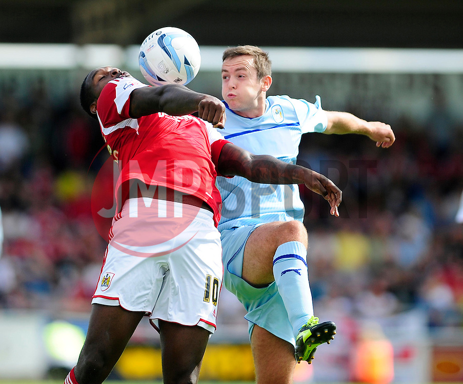 Bristol City's Jay Emmanuel-Thomas controls the ball under pressure from Coventry City's Blair Adams - Photo mandatory by-line: Dougie Allward/JMP - Tel: Mobile: 07966 386802 11/08/2013 - SPORT - FOOTBALL - Sixfields Stadium - Sixfields Stadium -  Coventry V Bristol City - Sky Bet League One