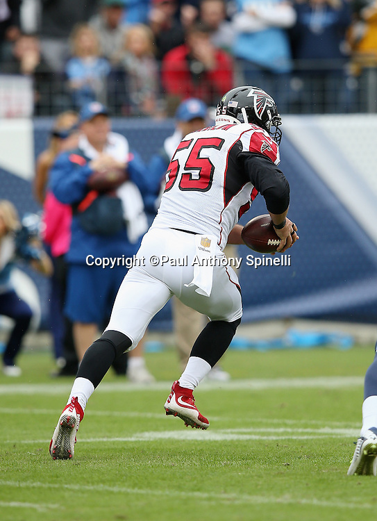 Atlanta Falcons linebacker Paul Worrilow (55) runs with the ball after intercepting a second quarter pass by the Tennessee Titans with four seconds left before halftime, stopping a scoring drive, during the 2015 week 7 regular season NFL football game against the Tennessee Titans on Sunday, Oct. 25, 2015 in Nashville, Tenn. The Falcons won the game 10-7. (©Paul Anthony Spinelli)