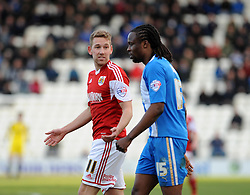 Bristol City's Scott Wagstaff  argues with Colchester United's Marcus Bean after being fouled by him - Photo mandatory by-line: Dougie Allward/JMP - Mobile: 07966 386802 22/03/2014 - SPORT - FOOTBALL - Colchester - Colchester Community Stadium - Colchester United v Bristol City - Sky Bet League One