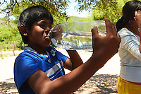 Guarani boy drinking clean water in Gutierrez, Santa Cruz, Bolivia