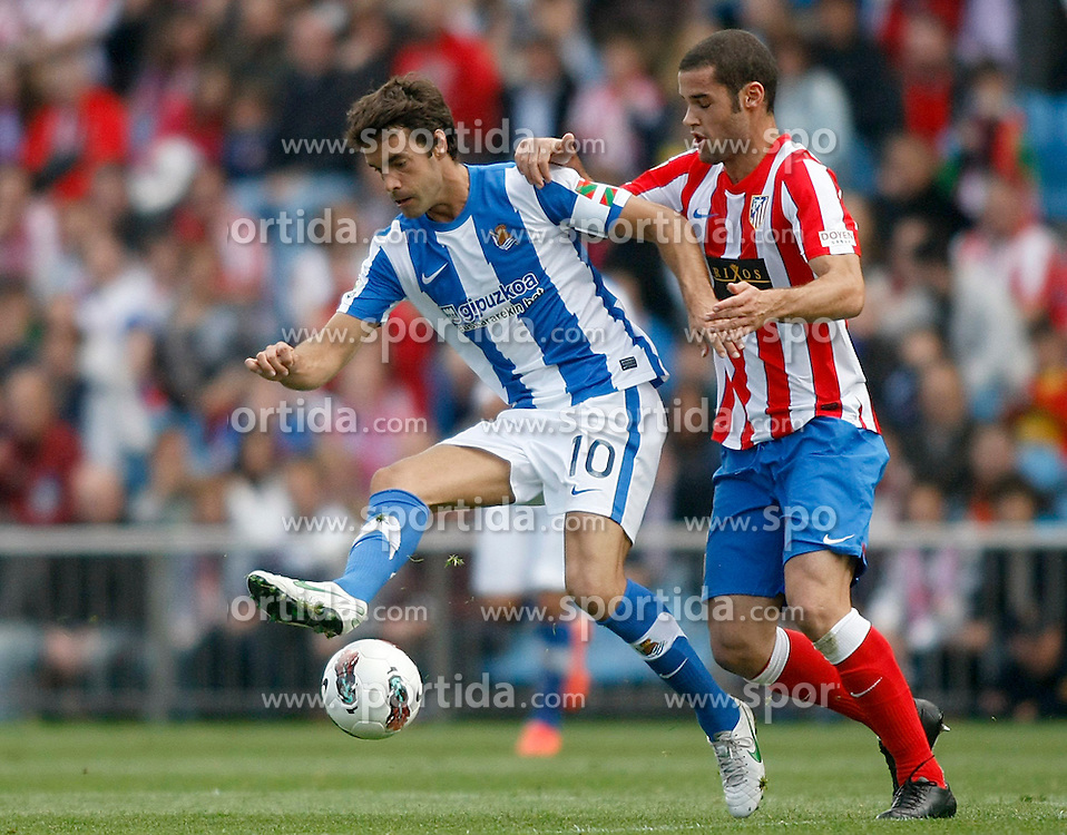 02.05.2012, Vicente Calderon Stadion, Madrid, ESP, Primera Division, Atletico Madrid vs Real Sociedad, Ersatztermin, im Bild Atletico de Madrid's Mario Suarez (r) and Real Sociedad's Xabi Prieto // during the football match of spanish 'primera divison' league, alternate date, between Atletico Madrid and Real Sociedad at Vicente Calderon stadium, Madrid, Spain on 2012/05/02. EXPA Pictures © 2012, PhotoCredit: EXPA/ Alterphotos/ Acero..***** ATTENTION - OUT OF ESP and SUI *****