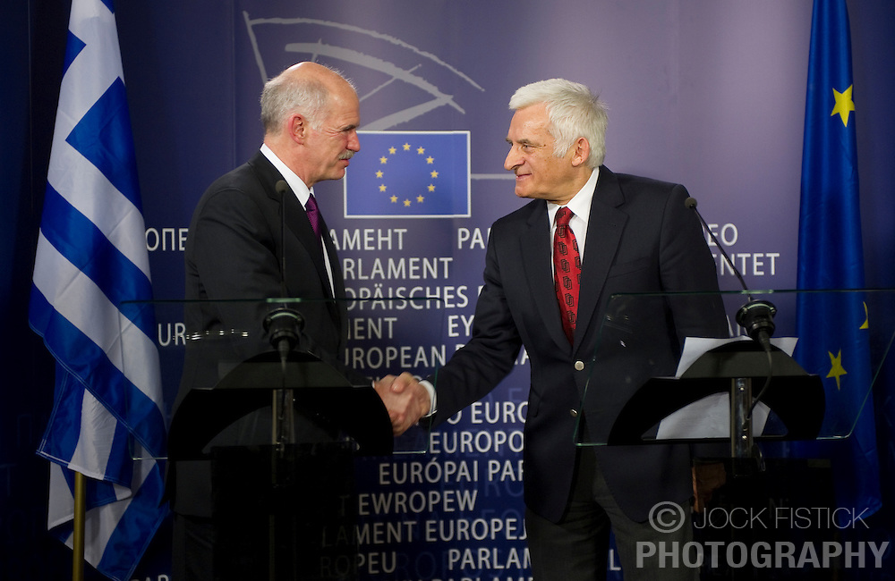 George Papandreou, Greece's prime minister, left, and Jerzy Buzek, president of the European Parliament, hold a press briefing following their meeting at the European Parliament headquarters in Brussels, Belgium, on Thursday, March 18, 2010. (Photo © Jock Fistick)