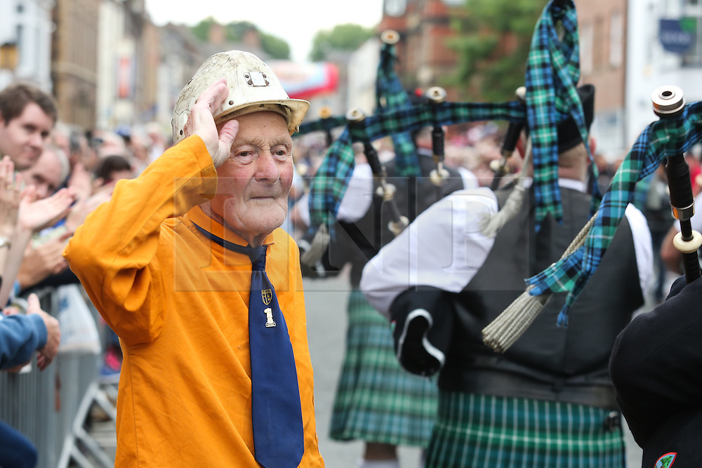 © Licensed to London News Pictures. 09/07/2016. Durham, UK. A former miner wearing his helmet salutes a passing band at the Durham Miners' Gala in County Durham, UK. The gala is a large gathering held annually associated with the coal mining heritage and trade unionism. Photo credit : Ian Hinchliffe/LNP