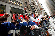 Young fans ditched class to cheer on the Super Bowl Champion New York Giants.   They react to seeing MVP QB Eli Manning holding the Lombari Trophy on a float in the ticker tape parade through the Canyon of Heros in Lower Manhattan.