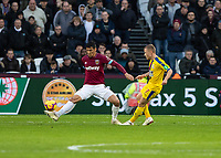 Football - 2018 / 2019 Premier League - West Ham United vs. Crystal Palace<br /> <br /> Fabian Balbuena (West Ham United) gets a leg in to block the shot from Max Meyer (Crystal Palace) at the London Stadium<br /> <br /> COLORSPORT/DANIEL BEARHAM