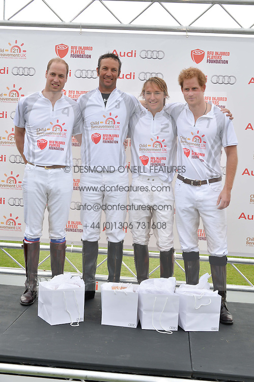 Left to right, HRH THE DUKE OF CAMBRIDGE, JOHN PAUL CLARKIN, MARK TOMLINSON and HRH PRINCE HARRY at the Audi Polo Challenge at Coworth Park, Blacknest Road, Ascot, Berkshire on 31st May 2015.