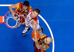 Vladimer Boisa of Georgia between Vojdan Stojanovski and Pero Antic of Macedonia during basketball game between National basketball teams of  Georgia and Former Yugoslav Republic of Macedonia at FIBA Europe Eurobasket Lithuania 2011, on September 8, 2011, in Siemens Arena,  Vilnius, Lithuania. (Photo by Vid Ponikvar / Sportida)