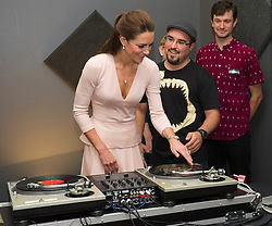 The Duke and Duchess of Cambridge have a go at being dj's during a visit to Northern Sound System in Adelaide, Australia on day 17 of their Royal Tour of New Zealand and Australia, Wednesday, 23rd April 2014. Picture by  i-Images / i-Images