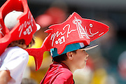 ANAHEIM, CA - AUGUST 12:  A Los Angeles Angels of Anaheim fan looks on wearing a foam hat during the game against the Seattle Mariners on Sunday, August 12, 2012 at Angel Stadium in Anaheim, California. The Mariners won the game 4-1. (Photo by Paul Spinelli/MLB Photos via Getty Images)