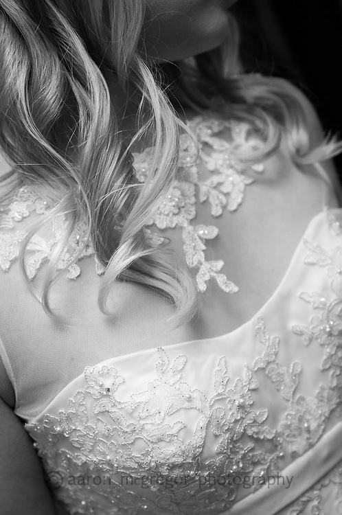 Locks of hair cascade over the wedding gown