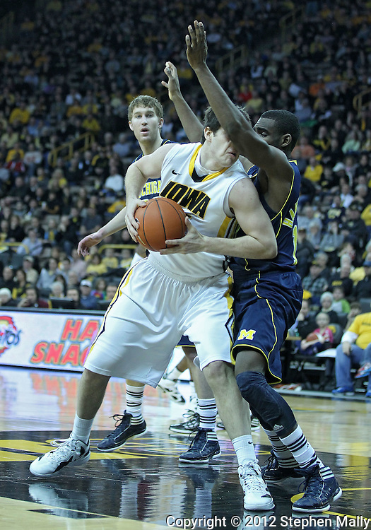 January 14, 2011: Iowa Hawkeyes forward Zach McCabe (15) turns into Michigan Wolverines guard Tim Hardaway Jr. (10) as he drives to the basket during the NCAA basketball game between the Michigan Wolverines and the Iowa Hawkeyes at Carver-Hawkeye Arena in Iowa City, Iowa on Saturday, January 14, 2011. Iowa defeated Michigan 75-59.