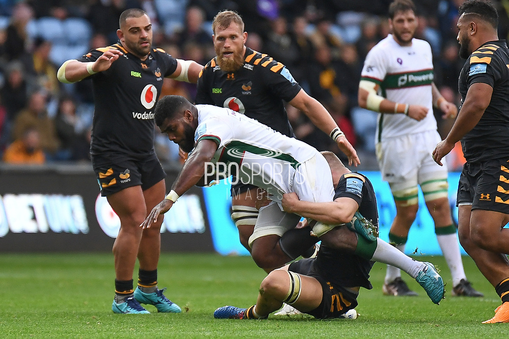 Wasps back row Jack Willis (7) tackles London Irish back row Albert Tuisue (8) during the Gallagher Premiership Rugby match between Wasps and London Irish at the Ricoh Arena, Coventry, England on 20 October 2019.