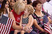 July 4, 2008 -- Phoenix, AZ: TERI TYDECK holds her niece, VIRGINIA JOYCE BURNS, while Tydeck, who is originally a Canadian citizen, is naturalized as a US citizen in Phoenix, AZ, Friday. About 300 people from 41 countries were naturalized as US citizens at South Mountain Community College, in Phoenix, AZ, Friday. It was the 20th year the college has hosted the Fiesta of Independence. More than 5,000 people have become naturalized US citizens at the Fiesta of Independence. More than 5,000 people have become naturalized US citizens at the Fiesta of Independence. The largest number of new citizens, 158, came from Mexico. There were also large numbers of new citizens from the Philippines, Bosnia-Herzegovnia and India.  Photo by Jack Kurtz