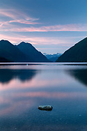 Sunset at Alouette Lake on a summer evening. Mountains in the background include Mount Nutt (left), Mount Gatey, Mount Clarke and Mount Ratney (back, right). Photographed on the beach at Alouette lake in Golden Ears Provincial Park - Maple Ridge, British Columbia, Canada.