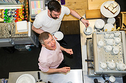 Pictured: Willie Rennie was shown  how to make great coffee by cafe worker Graham Burnett.<br /> <br /> Scottish Liberal Democrat leader Willie Rennie met staff and customers at the Grassmarket caf&eacute;, part of the Grassmarket Community Project, as he visited the Edinburgh social enterprise today as part of his election campaign. He took the opportunity to set out Lib Dem student support plans ahead of an NUS election hustings in Glasgow. <br /> Ger Harley | EEm 11 April 2016