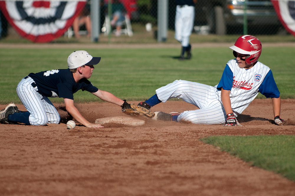 Lathan Goumas | The Bay City Times..Mitchell Dominowski, of the Midland Northeast 11-Under Little League  team,  slides safely into second base during a state championship semifinal game against Taylor Northwest at Plymouth Park in Midland, MI. on Monday August 1, 2011. Midland Northeast defeated Taylor Northwest 10-0 in five innings.