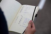 Een trainer kijkt naar het protocol. In Lelystad test het HPT voor de laatste keer de nieuwe fiets op de RDW baan. In september wil het Human Power Team Delft en Amsterdam, dat bestaat uit studenten van de TU Delft en de VU Amsterdam, tijdens de World Human Powered Speed Challenge in Nevada een poging doen het wereldrecord snelfietsen voor vrouwen te verbreken met de VeloX 7, een gestroomlijnde ligfiets. Het record is met 121,44 km/h sinds 2009 in handen van de Francaise Barbara Buatois. De Canadees Todd Reichert is de snelste man met 144,17 km/h sinds 2016.<br /> <br /> In Lelystad the team tests the new bike for the last time before the record attempts. With the VeloX 7, a special recumbent bike, the Human Power Team Delft and Amsterdam, consisting of students of the TU Delft and the VU Amsterdam, also wants to set a new woman's world record cycling in September at the World Human Powered Speed Challenge in Nevada. The current speed record is 121,44 km/h, set in 2009 by Barbara Buatois. The fastest man is Todd Reichert with 144,17 km/h.