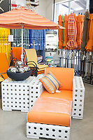 Variety of patio umbrellas and seating furniture in garden furniture store