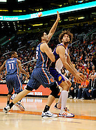 Feb. 4, 2012; Phoenix, AZ, USA; Phoenix Suns center Robin Lopez (15) is guarded by the Charlotte Bobcats center Byron Mullens (22) during the second half at the US Airways Center. The Suns defeated the Bobcats 95 - 89. Mandatory Credit: Jennifer Stewart-US PRESSWIRE..