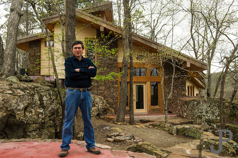 Ben Pearson in front of his newest cabin at Longbow Resorts.