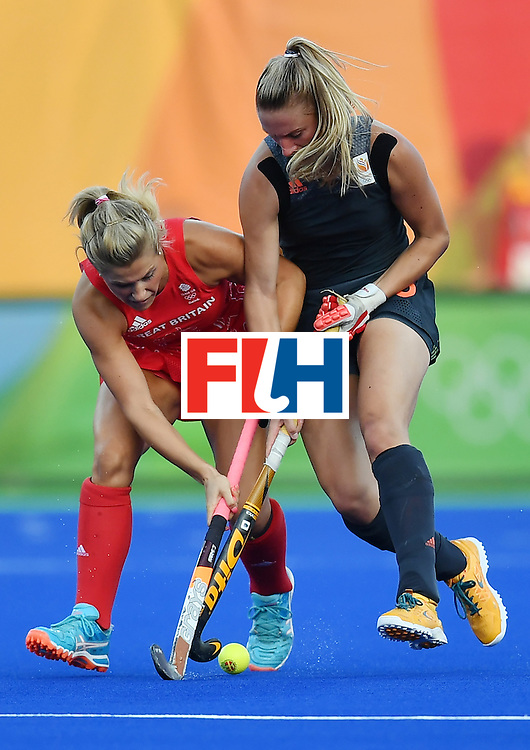 Britain's Georgie Twigg (L) vies with Netherlands' Laurien Leurink during the women's Gold medal hockey Netherlands vs Britain match of the Rio 2016 Olympics Games at the Olympic Hockey Centre in Rio de Janeiro on August 19, 2016. / AFP / MANAN VATSYAYANA        (Photo credit should read MANAN VATSYAYANA/AFP/Getty Images)