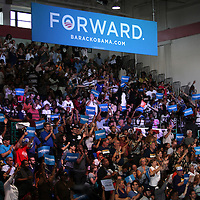 Supporters cheer as President Barack Obama speaks during his Grassroots event at the Kissimmee Civic Center in Kissimmee, Florida on Saturday, September 8, 2012. (AP Photo/Alex Menendez)
