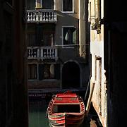 Italy, Veneto, Venice. November/12/2007...A small canal and boat in Venice, Italy..