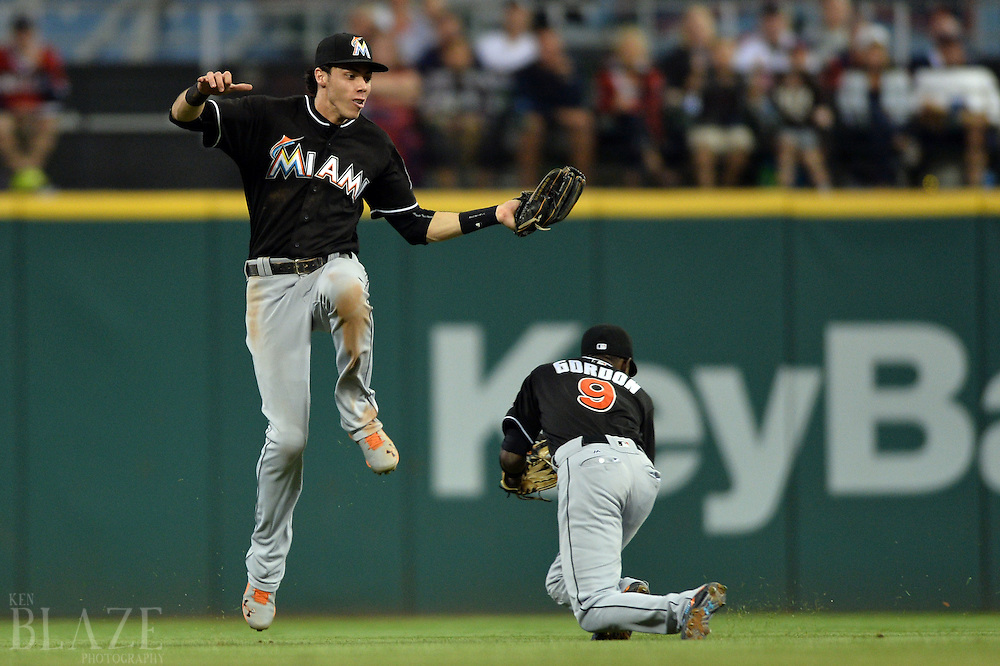 Sep 3, 2016; Cleveland, OH, USA; Miami Marlins center fielder Christian Yelich (21) grabs a fly ball hit by Cleveland Indians third baseman Jose Ramirez (not pictured) while avoiding second baseman Dee Gordon (9) during the sixth inning at Progressive Field. Mandatory Credit: Ken Blaze-USA TODAY Sports