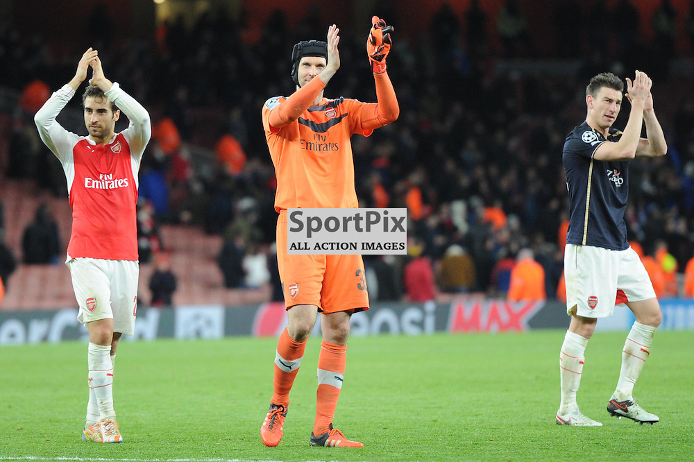 Arsenals Mathieu Flamini, Petr Cech and Laurent Koscielny applaud the the Arsenal v Dinamo Zagreb game in the UEFA Champions League on the 24th November 2015 at the Emirates Stadium.