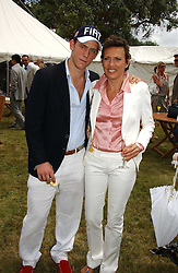 "CARLO CARELLO and his mother SARA CARELLO at the Goodwood Festival of Speed on 9th July 2006.  Cartier sponsored the ""Style Et Luxe' for vintage cars on the final day of this annual event at Goodwood House, West Sussex and hosted a lunch.<br />