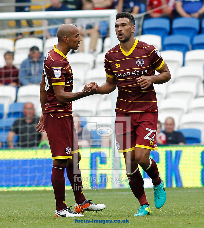 Steven Caulker (R) celebrates the first goal of Queens Park Rangers during the Sky Bet Championship match at the Cardiff City Stadium, Cardiff<br /> Picture by Mike Griffiths/Focus Images Ltd +44 7766 223933<br /> 14/08/2016