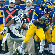 Delaware WR (#5) Rob Jones catches a 19 yard pass to the UNH 34. No. 5 Delaware defeats No.11 New Hampshire 16-3 on a brisk Friday night at Delaware stadium in Newark Delaware...Delaware will host the Division I FCS Championship Semifinals Round next weekend.