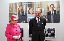 Queen Elizabeth II and the Duke of Edinburgh as they visit the Royal Mail Windsor delivery office in Berkshire to mark the 500th anniversary of the postal service as the monarch begins her 90th birthday celebrations.