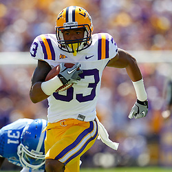 October 1, 2011; Baton Rouge, LA, USA;  LSU Tigers wide receiver Odell Beckham (33) breaks away from Kentucky Wildcats safety Mikie Benton (31) for a touchdown during the second quarter at Tiger Stadium.  Mandatory Credit: Derick E. Hingle-US PRESSWIRE / © Derick E. Hingle 2011
