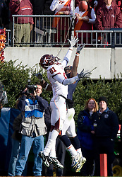 Virginia Tech wide receiver Justin Harper (81) and Virginia cornerback Vic Hall (4) go up for a pass.  The #8 ranked Virginia Tech Hokies defeated the #16 ranked Virginia Cavaliers 33-21 at Scott Stadium in Charlottesville, VA on November 24, 2007.