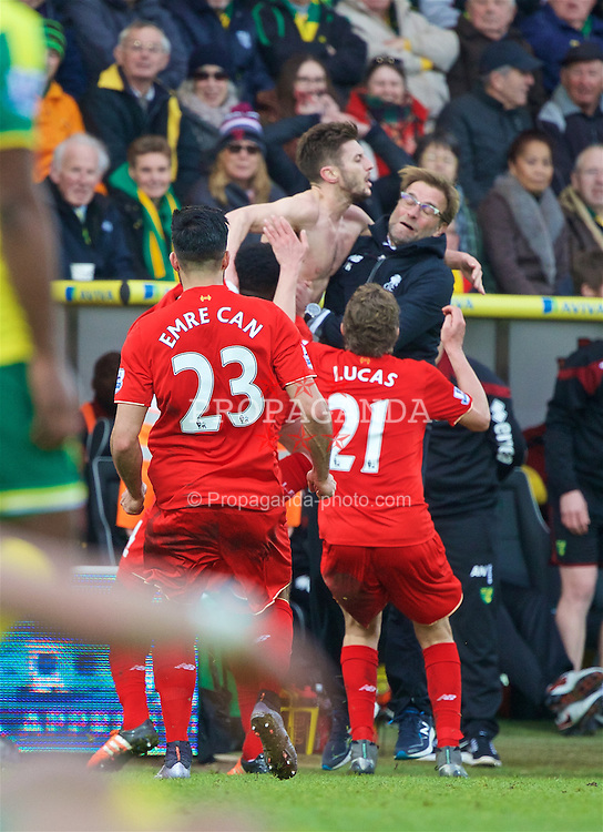 NORWICH, ENGLAND - Friday, January 22, 2016: Liverpool's Adam Lallana celebrates scoring the fifth, and winning, goal against Norwich City to seal a late 5-4 victory with manager Jürgen Klopp during the Premiership match at Carrow Road. (Pic by David Rawcliffe/Propaganda)
