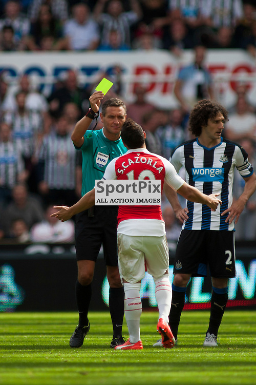 Cazorla shown the yellow card by referee Andre Marriner in the Newcastle United v Arsenal Barclays Premier League match at St James' Park Newcastle 29 August 2015<br /><br />(c) Russell G Sneddon / SportPix.org.uk