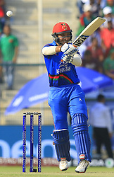 September 20, 2018 - Abu Dhabi, United Arab Emirates - Afghanistan cricketer Rahmat Shah plays a shot during the 6th cricket match of Asia Cup 2018 between Bangladesh and Afghanistan at the Sheikh Zayed Stadium,Abu Dhabi, United Arab Emirates on September 20, 2018. (Credit Image: © Tharaka Basnayaka/NurPhoto/ZUMA Press)
