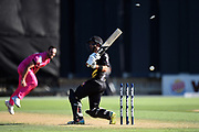 Wellington Firebirds' Troy Johnson out bowled to Northern Knights' Daryl Mitchell during the Burger King Super Smash game between Wellington Firebirds vs Northern Knights, Basin Reserve, Wellington, Saturday 12th January 2019. Copyright Photo: Raghavan Venugopal / © www.Photosport.nz 2019
