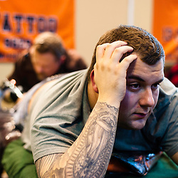 Manchester, UK - 4 August 2012: a visitor is tattooed during the Manchester Tattoo Show, one of the most popular conventions of the UK tattoo community.