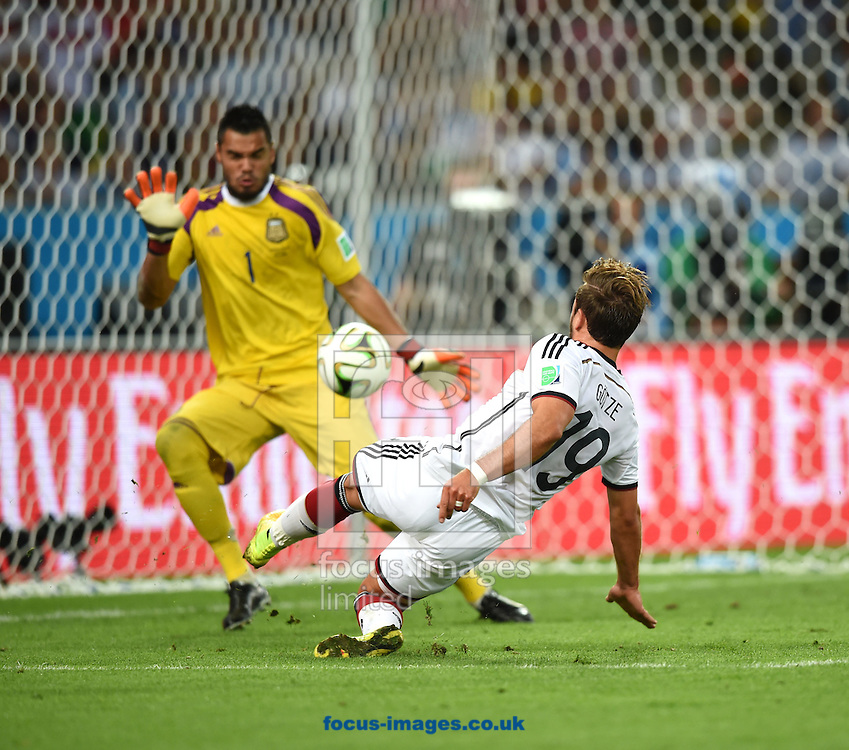 Mario Gotze of Germany shoots and scores past Sergio Romero of Argentina during the 2014 FIFA World Cup final at Maracana Stadium, Rio de Janeiro<br /> Picture by Stefano Gnech/Focus Images Ltd +39 333 1641678<br /> 13/07/2014