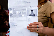 Police fingerprinted Roma Gypsies ID cards.Roma Gypsies victims of racism and discrimination, often forcibly evicted or moved from one camp to another, marginalized, living on the periphery of urban centres. The Roma Gypsies originated from India where they left over a thousand years before. Tribes moved across Euroasia eventually arriving in Europe in the 14th century. They have survived 500 years of slavery and persecution. They moved from place to place, often nomadic in search of work. Now many live in container camps, some are unemployed, others work the markets, or import export. Rome, Italy.