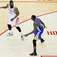 25 May 2015: Golden State Warriors forward Draymond Green (23) defends on Houston Rockets guard James Harden (13) during the Houston Rockets 128-115 victory over the Golden State Warriors, in game 4 of the Western Conference finals, at the Toyota Center, Houston, Texas, USA.