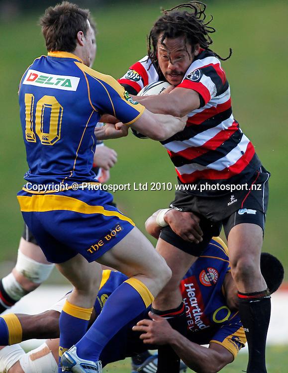 Counties player Tana Umaga fends Otago player Glenn Dickson. ITM Cup Rugby, Counties Manukau v Otago, Bayer Growers Stadium, Pukekohe. Saturday 31st July 2010. Photo: Simon Watts/PHOTOSPORT