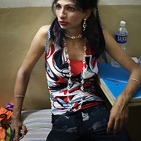 A transgender spends an evening with friends in a hotel in the town of Vilappuram during the week-long transgender gathering.  ..India's transexual community has a recorded history of more than four thousand years. Many consider the The Third Sex, also known as Aravanis, to posses special powers allowing them to determine the fate of others. As such, they are not only revered but despised and feared too. Resigned to the fringes of society, segregated and excluded from most occupations, many Aravanis are forced to turn to begging and sex work in order to earn a living. ..The annual transgender festival in the village of Koovagam, near Vilappuram, offers an escape from this often desolate existence. For some, the week-long partying and frenetic sex trade that culminates in the Koovagam festival is about fulfilling lustful desires. For others, the gathering provides a chance for transgenders to bond, share experiences, join the wider homosexual gay-community and coordinate their campaign for recognition and tackle the challenge of HIV/AIDS. ..It is the Indian state of Tamil Nadu that the eighty-thousand-strong Aravani community has made advances in their fight for rights. In 2009, the Tamil Nadu state government began providing sex-change surgery free of cost. The state has also offers special third-gender ration cards, passports and reserved seats in colleges. And 2008 the launch of Ippudikku Rose, a Tamil talk-show fronted by India's first transgender TV-host and the release of a mainstream Tamil film staring an Aravani in the lead-role. ..These advances clearly signal a victory for south India's transgenders, but they have also exposed deep divisions within the community. There is a very real gulf that separates the majority poor from their potentially influential but often reticent, upper-class sisters. ..Photo: Tom Pietrasik.Vilappuram District, Tamil Nadu. India.May 2009