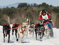 Diane Marquis of Saint. Medard, Quebec brings her dog team (sponsors WEMJ-1490 AM and Casella) towards the finish line during the first Open Class race of the 86th annual Laconia World Championship Sled Dog Races Friday afternoon.  (Karen Bobotas/for the Laconia Daily Sun)