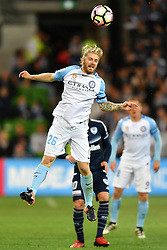 December 17, 2016 - Melbourne, Victoria, Australia - LUKE BRATTAN (26) of Melbourne City jumps for the ball in the round 11 match of the A-League between Melbourne City and Melbourne Victory at AAMI Park, Melbourne, Australia. Victory won 2-1 (Credit Image: © Sydney Low via ZUMA Wire)