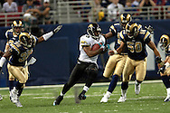 Jacksonville running back Fred Taylor (28) rushes up field past St. Louis defenders Corey Ivy (35) and Pisa Tinoisamoa (50) for 19-yards in the first quarter at the Edward Jones Dome in St. Louis, Missouri, October 30, 2005.  The Rams beat the Jaguars 24-21.